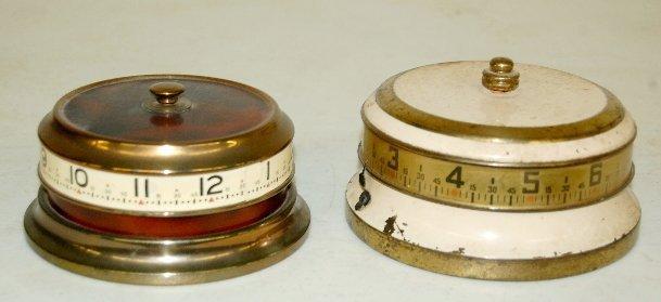 10: 2 Tape Measure Clocks, U.S.A. & German