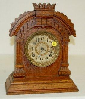 13: Antique Oak Ansonia Cabinet Clock, T & S