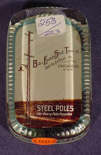 1002: Oblong Glass Paperweight Advertising Bates Steel