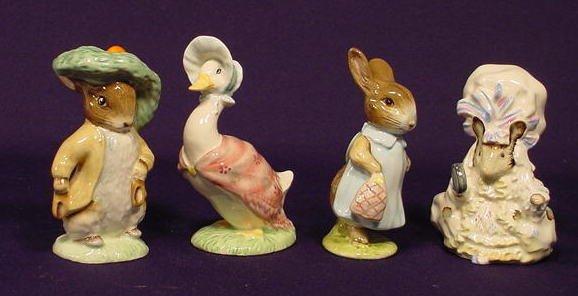 1006: Four Beatrix Potter Peter Rabbit Figurines NR