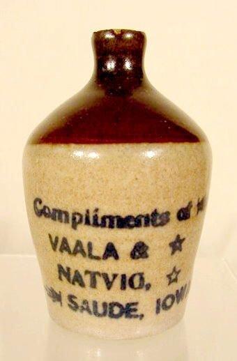 1594: Mini Advertising Stoneware Jug, Saude, IA NR