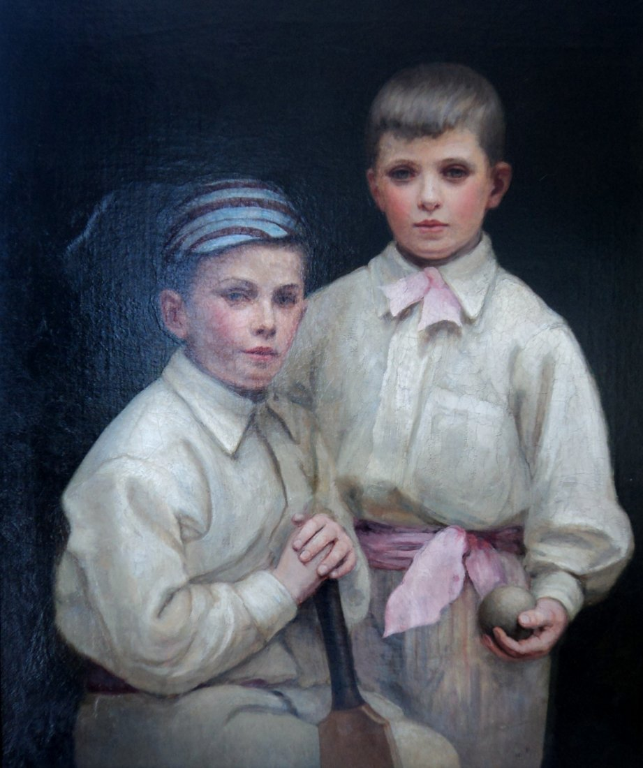 Portrait of two young boys in cricketing attire