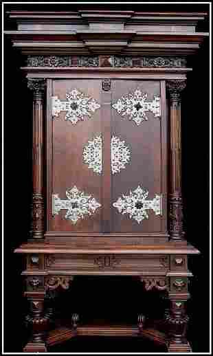 Carved Gothic Cabinet w/Birdseye Maple Interior.