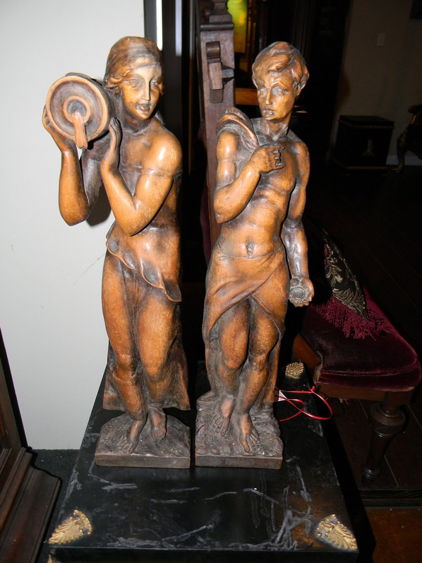 Two Carved wooden Figures