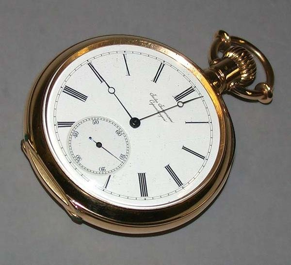 23: Gold Openface Bow-Set Watch
