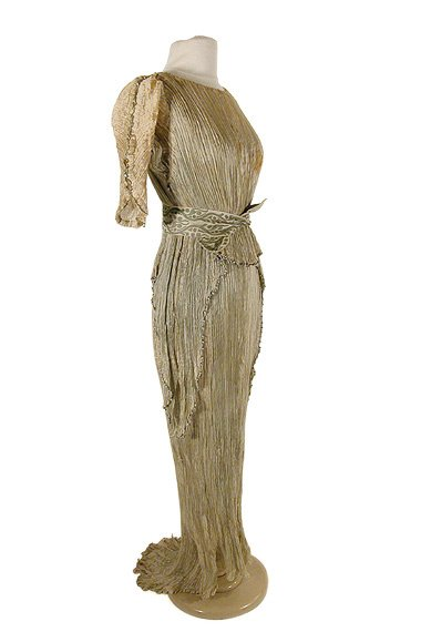 1013: Fortuny Almond Silk Fortuny Peplos Gown