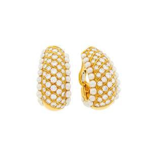 Van Cleef & Arpels Pair of Gold, Diamond and Split
