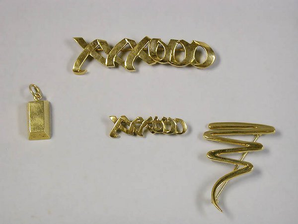 4002A: Three Gold Pins and a Pendant