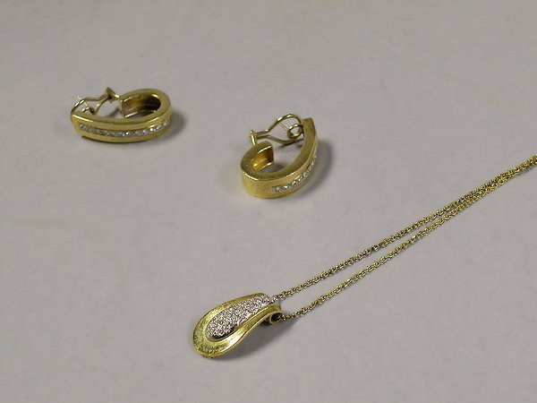 4010D: Pair of Gold and Diamond Earrings and a Pendant