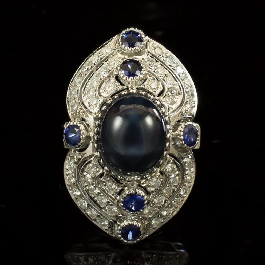 14K Gold 12.60ct Star Sapphire, 0.55ct Sapphire  1.41ct