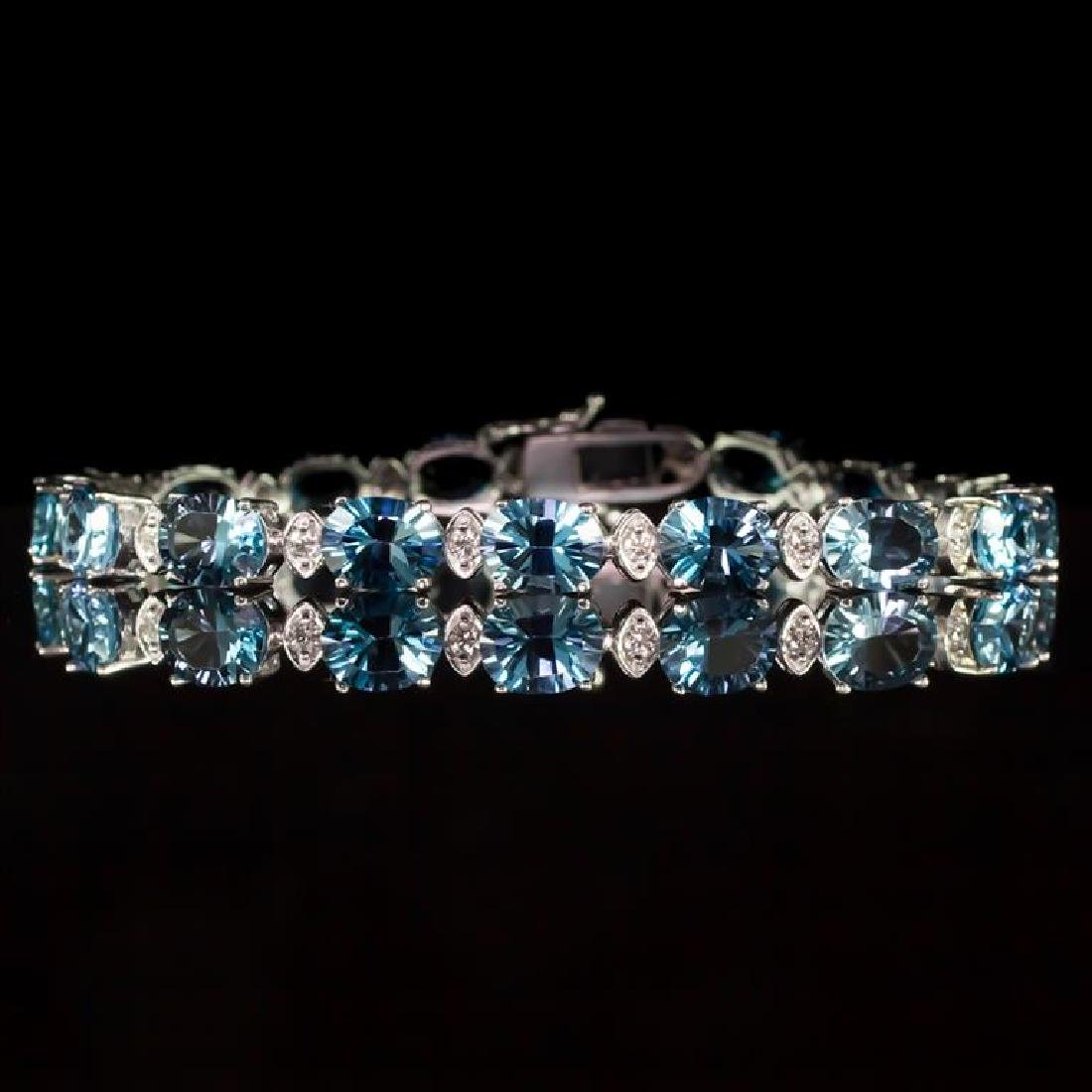 14K Gold 22.68ct Blue Topaz 0.80ct Diamond Bracelet