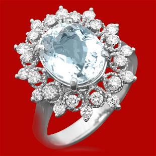 4k Gold 3.23ct Aquamarine 0.65ct Diamond Ring