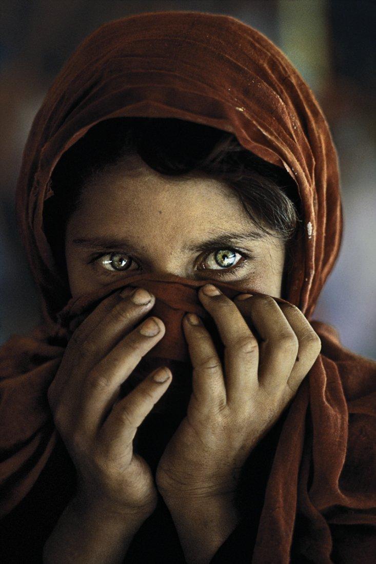 Steve McCurry: Afghan Girl with Hands on Face