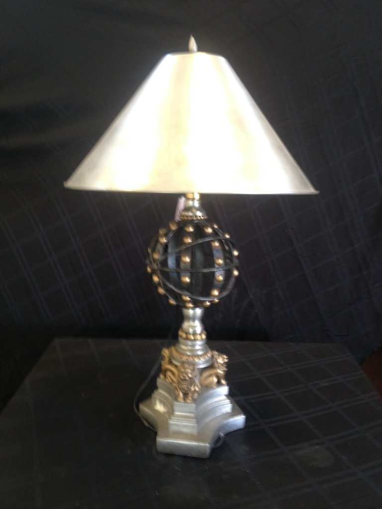 Pair of mid century style lamps with lions on base.