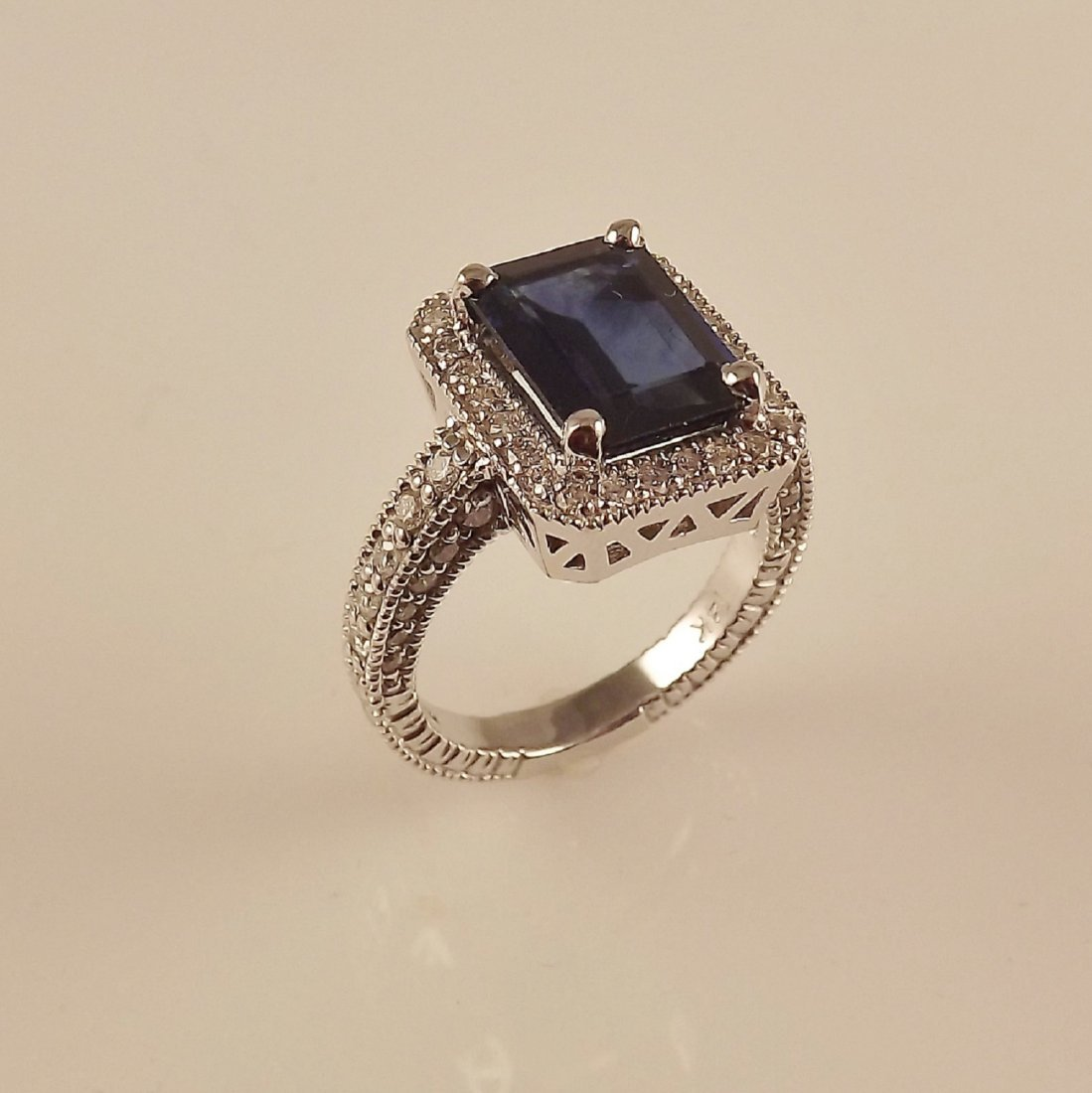 14K W.G. Ring with 4.01ct Sapphire and 0.80ctw Diamonds