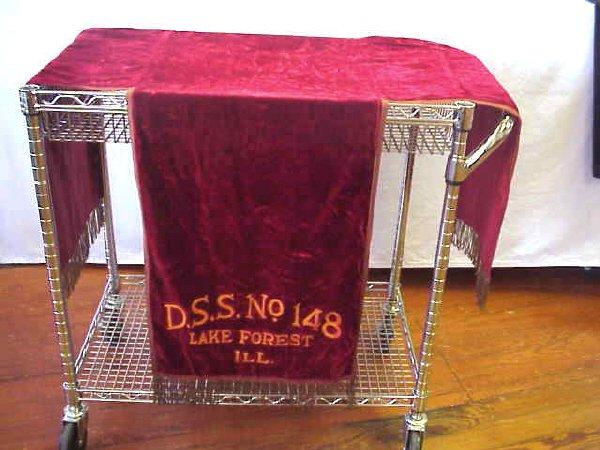 19: Red velvet lodge table cover.