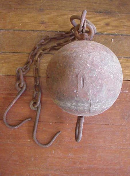 21: Iron ball and chain.