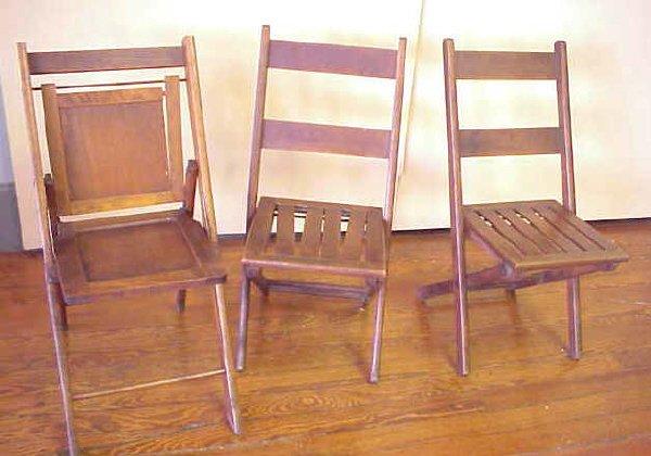 3: 3 wood folding chairs.