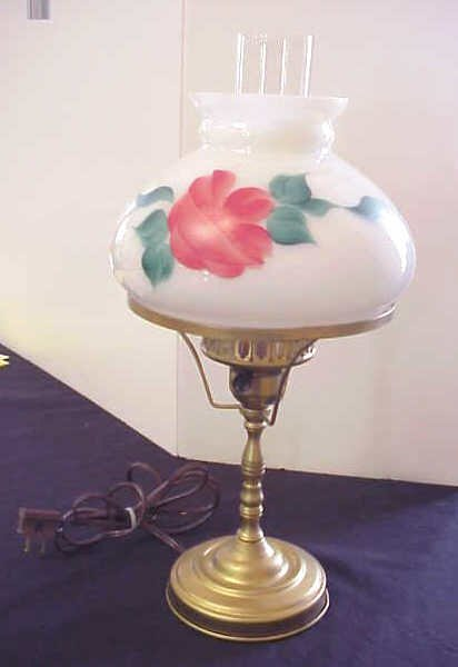 5: Small lamp, floral decorated shade.