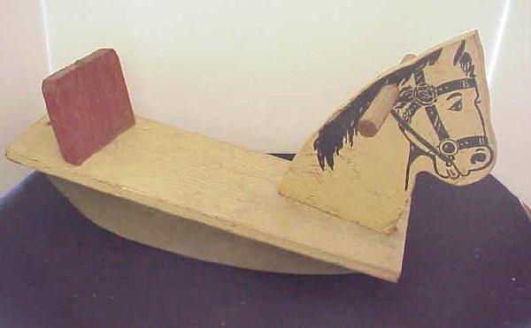 6: Primitive child's rocking horse.