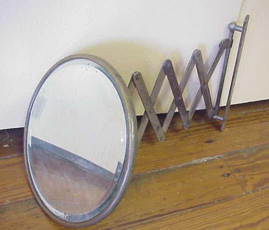 8: Retractable beveled glass shaving mirror.