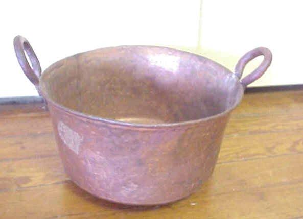 10: Hand made copper bucket.