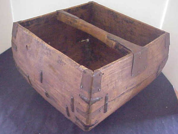 14: Primitive dovetail handled rice box.