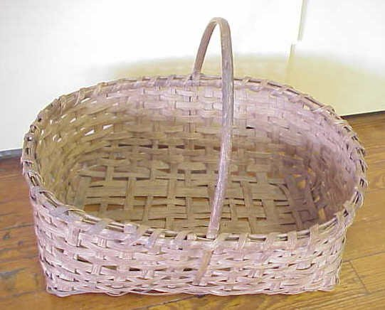 18: Hand woven basket with handles.