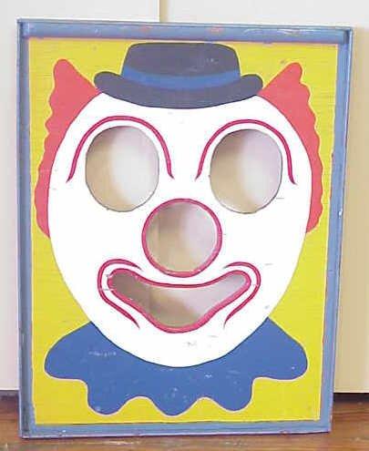 24: Clown bean-bag toss board.