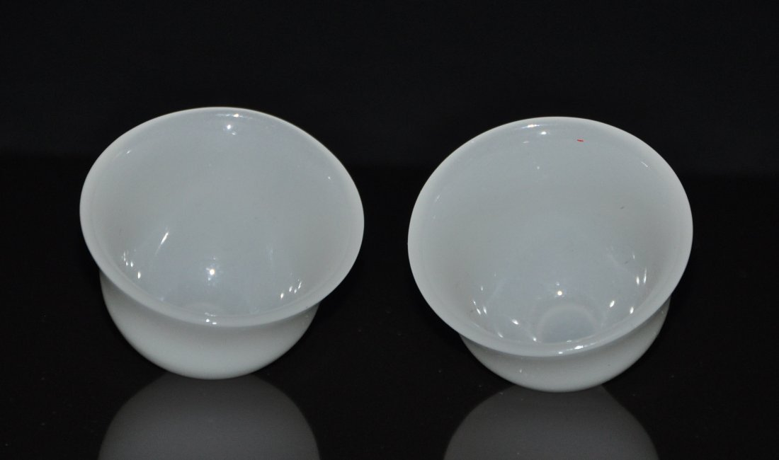 A pair of white jade cups