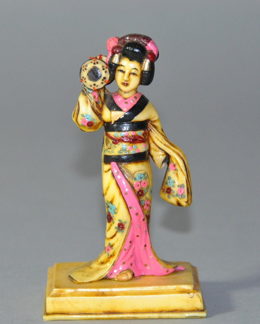 A Japanese carving of a woman