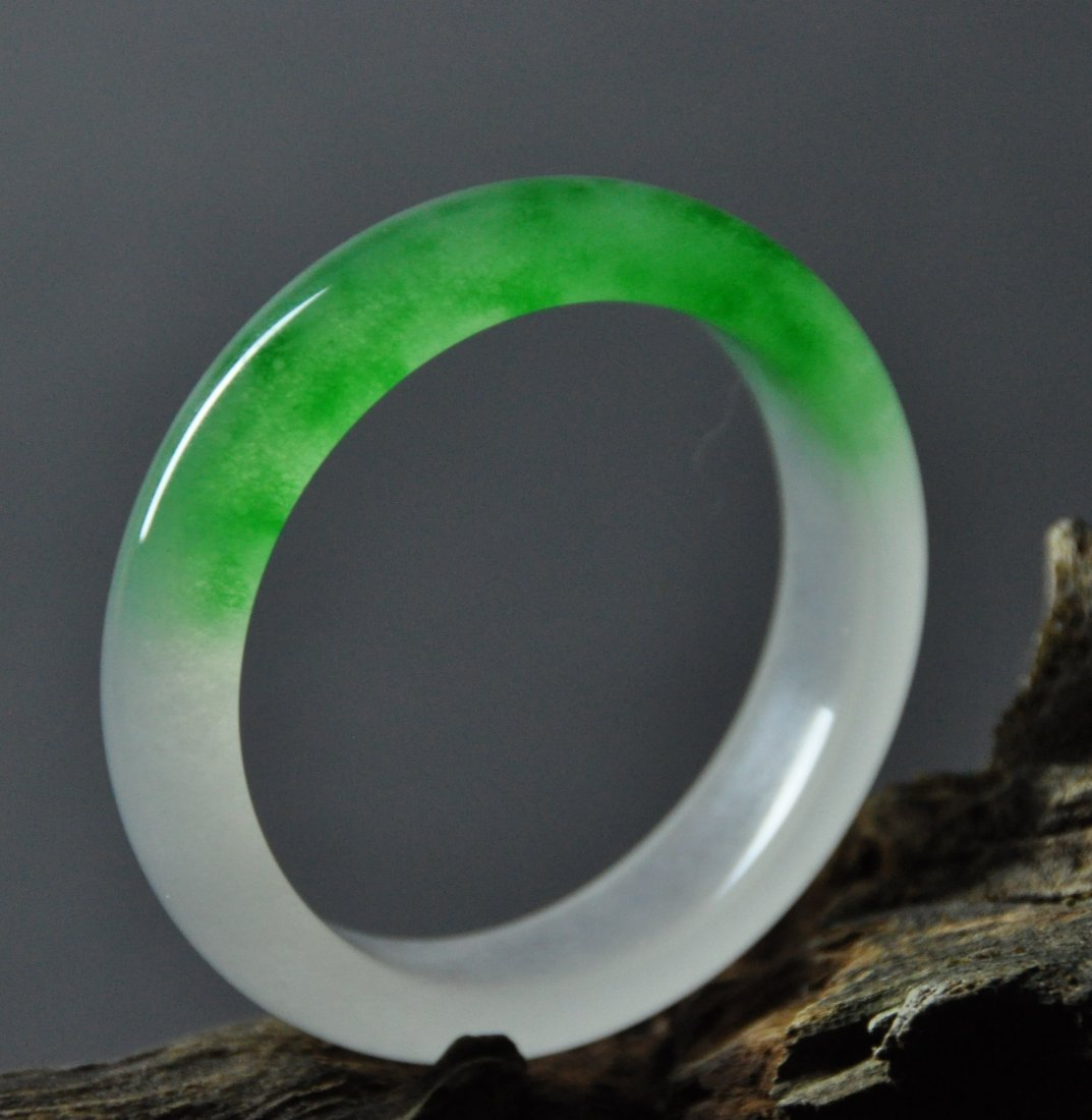 A translucent green and white jadeite bangle