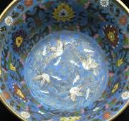 A Qing Dynasty cloisonne giltbronze censer tripod