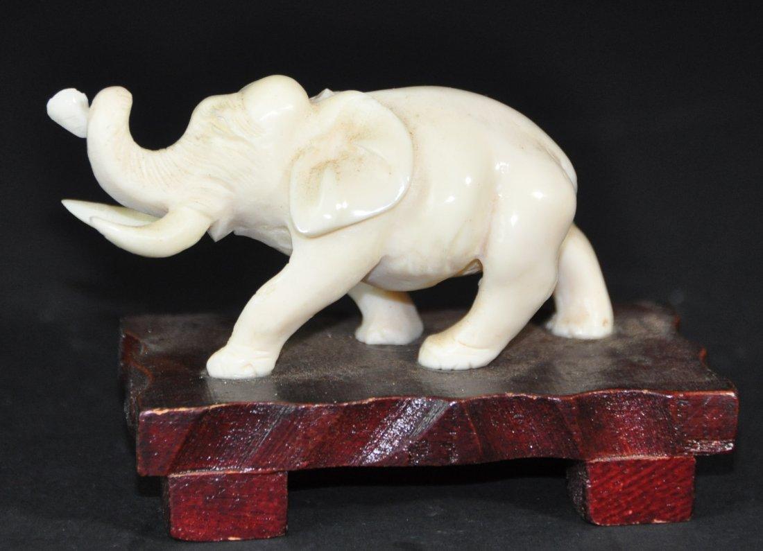 A carved Elephant figure