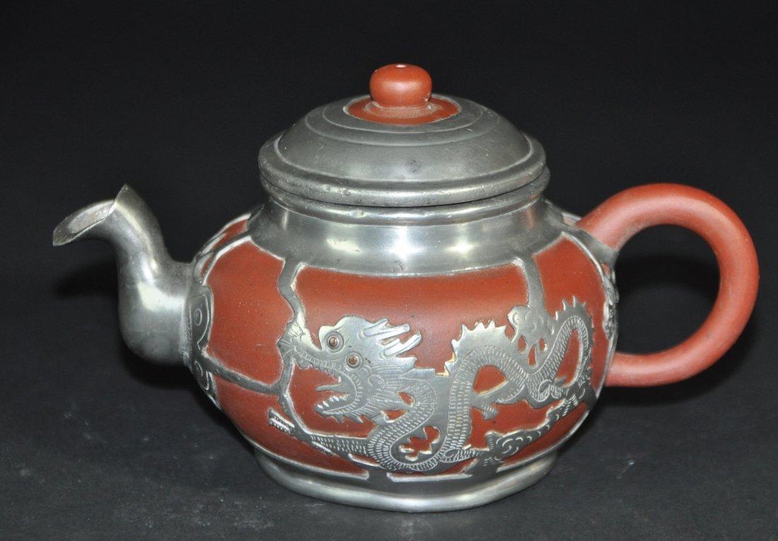 A Yi Xing and tin teapot