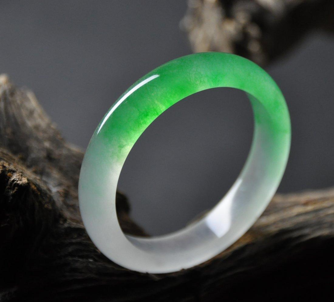 A fine translucent green and white  jadeite bangle
