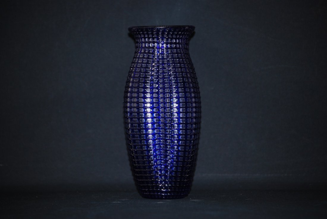 A hand-crafted 19th century glass flower vase