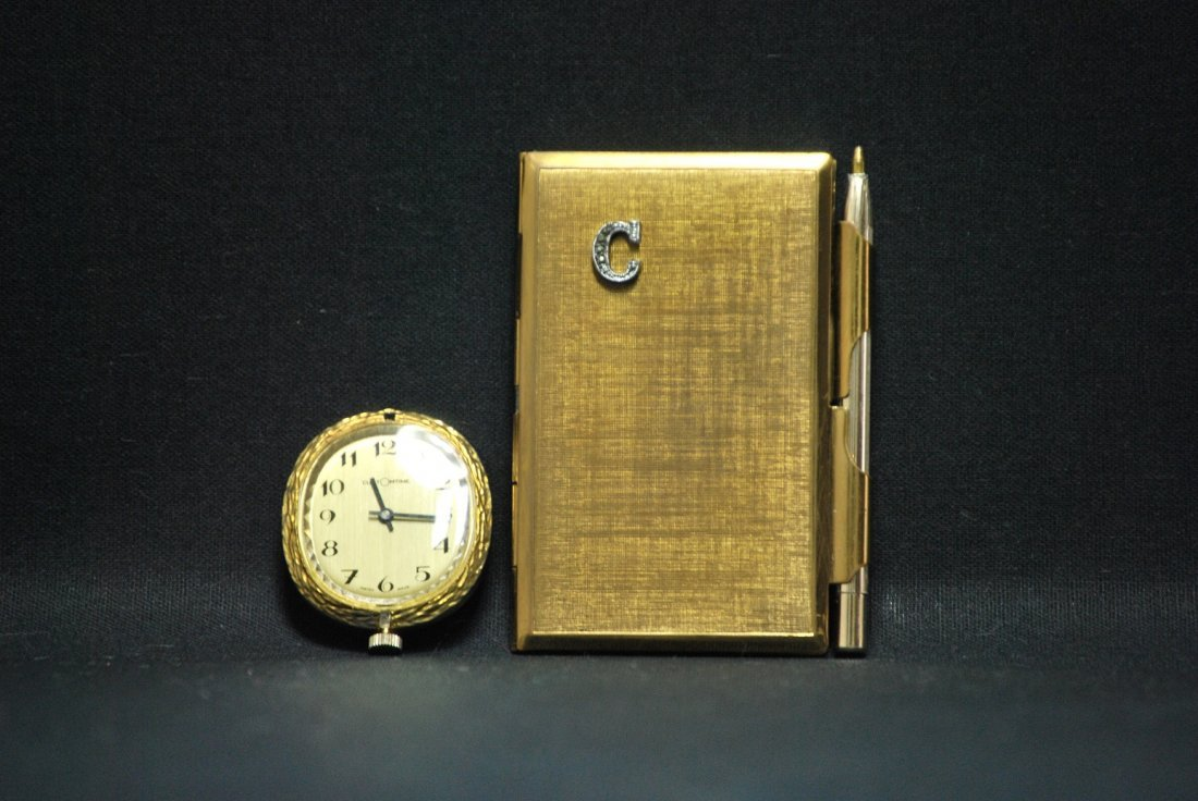 A 10K Swiss pocketwatch and a 19th century business