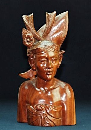 A Bali Wood carving of a man