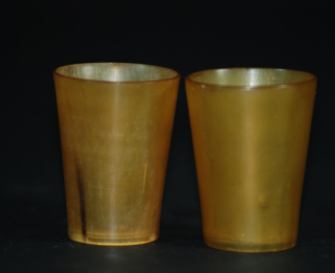 A pair of antique horn cups