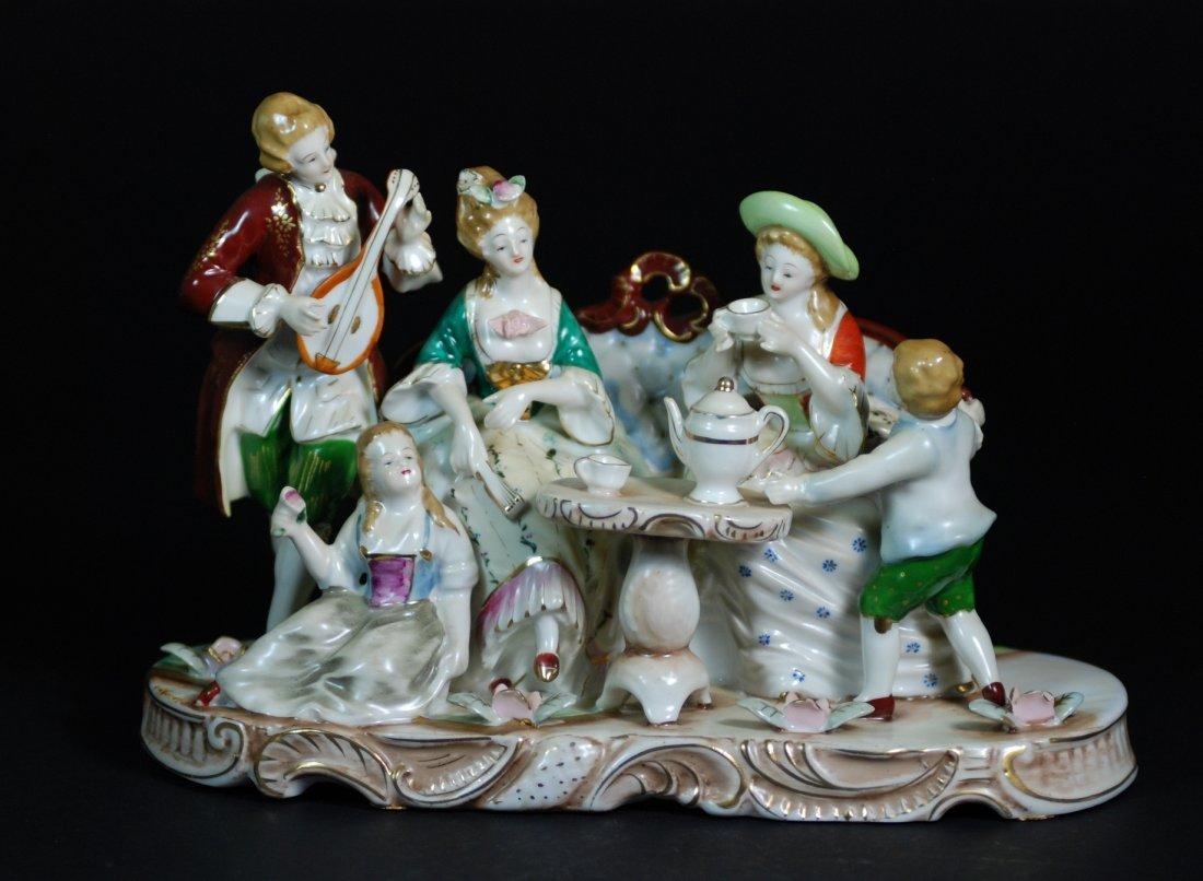 An antique royal polychrome decorated porcelain figural