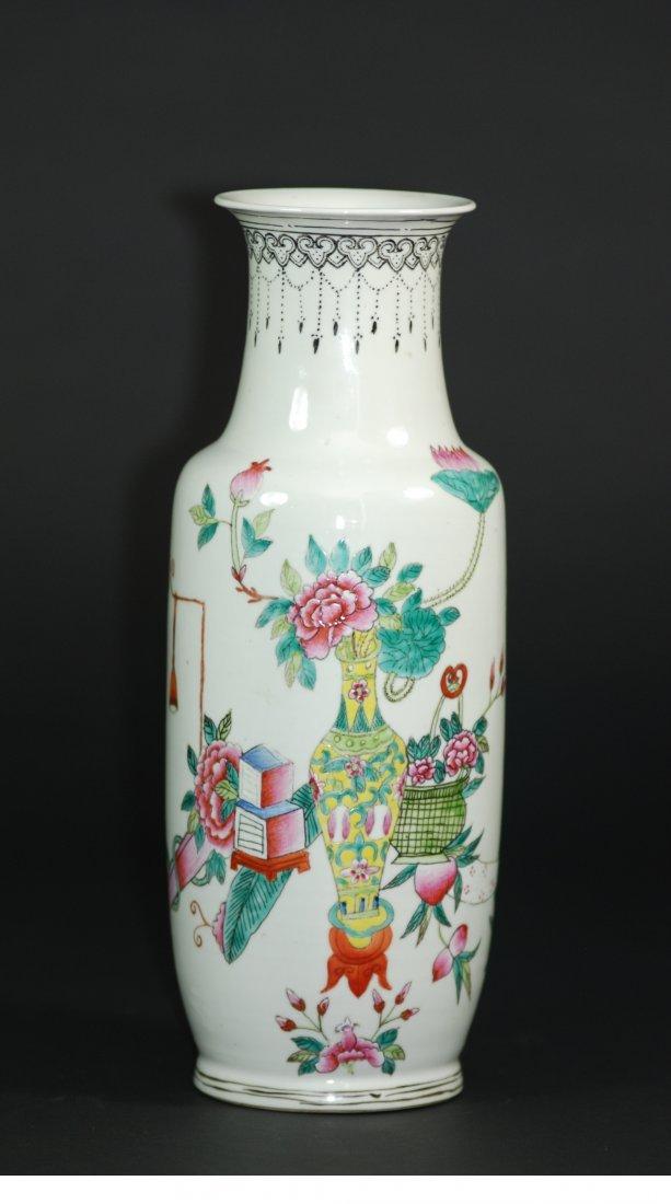 A Qing Dynasty Qianlong famille rose vase