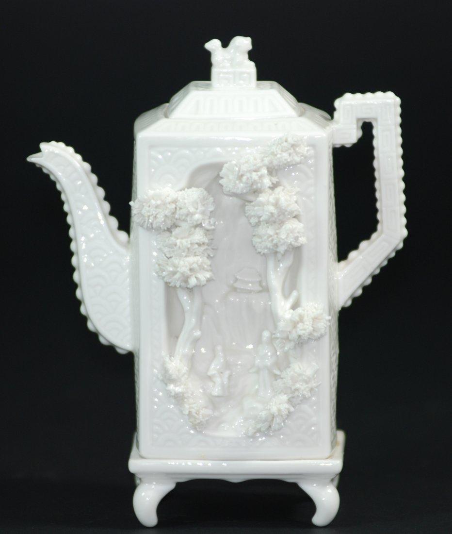 A Qing Dynasty Dehua porcelain carved decoration teapot