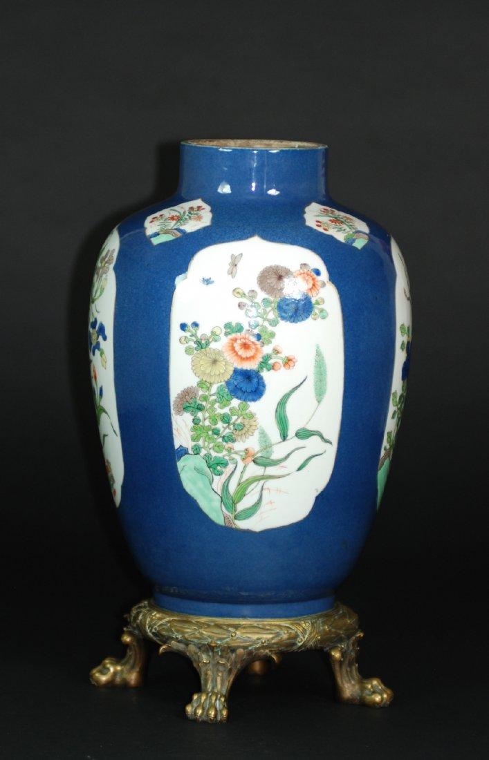A fine Kangxi period famille rose powder-blue-ground