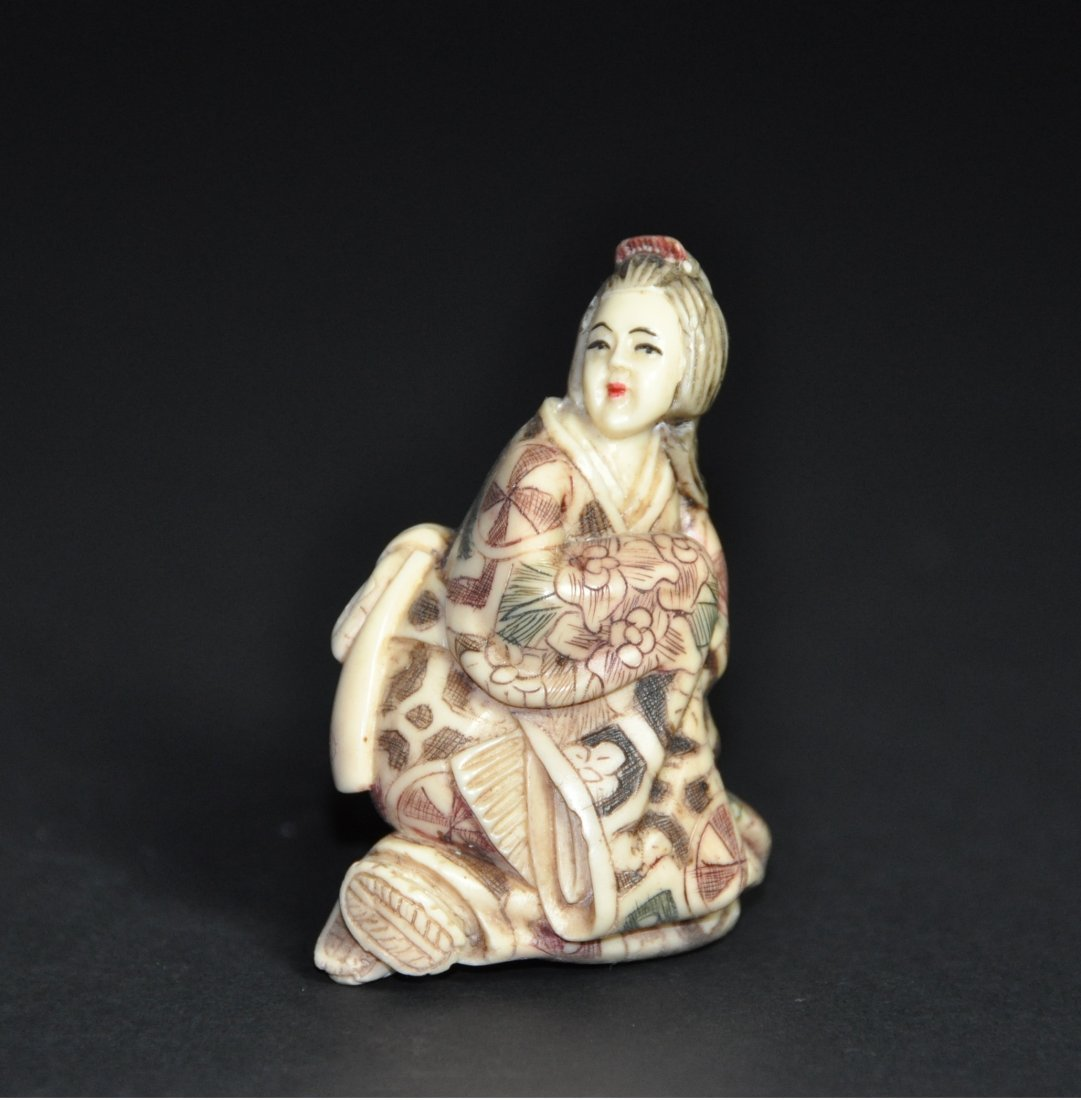 A Japanese carved figural