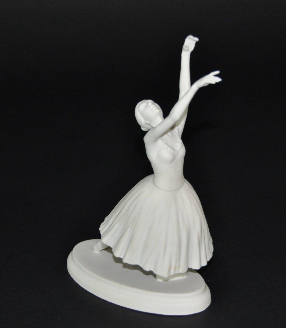 A  porcelain figural group dancing woman