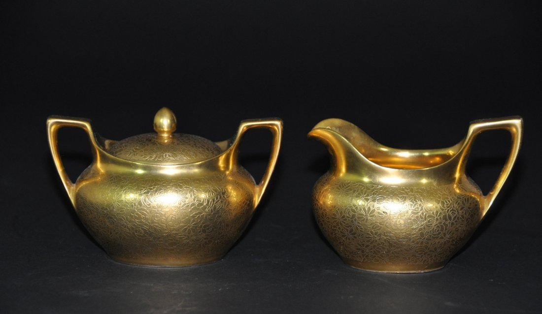 A German porcelain gold -glazed coffee cup