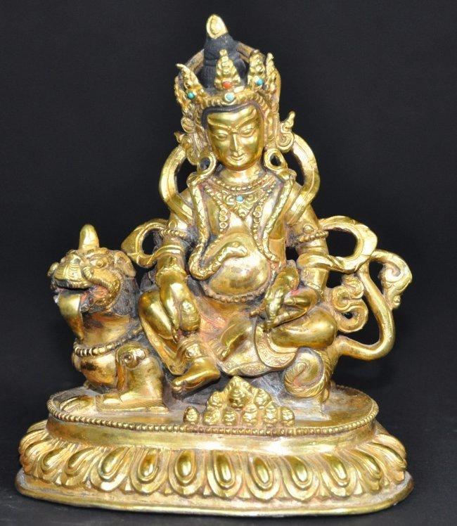 A 16th/17th century gilt-bronze Tibetan Manjushri