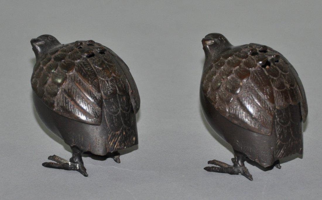A pair of Japanese Meiji period bronze bird incense
