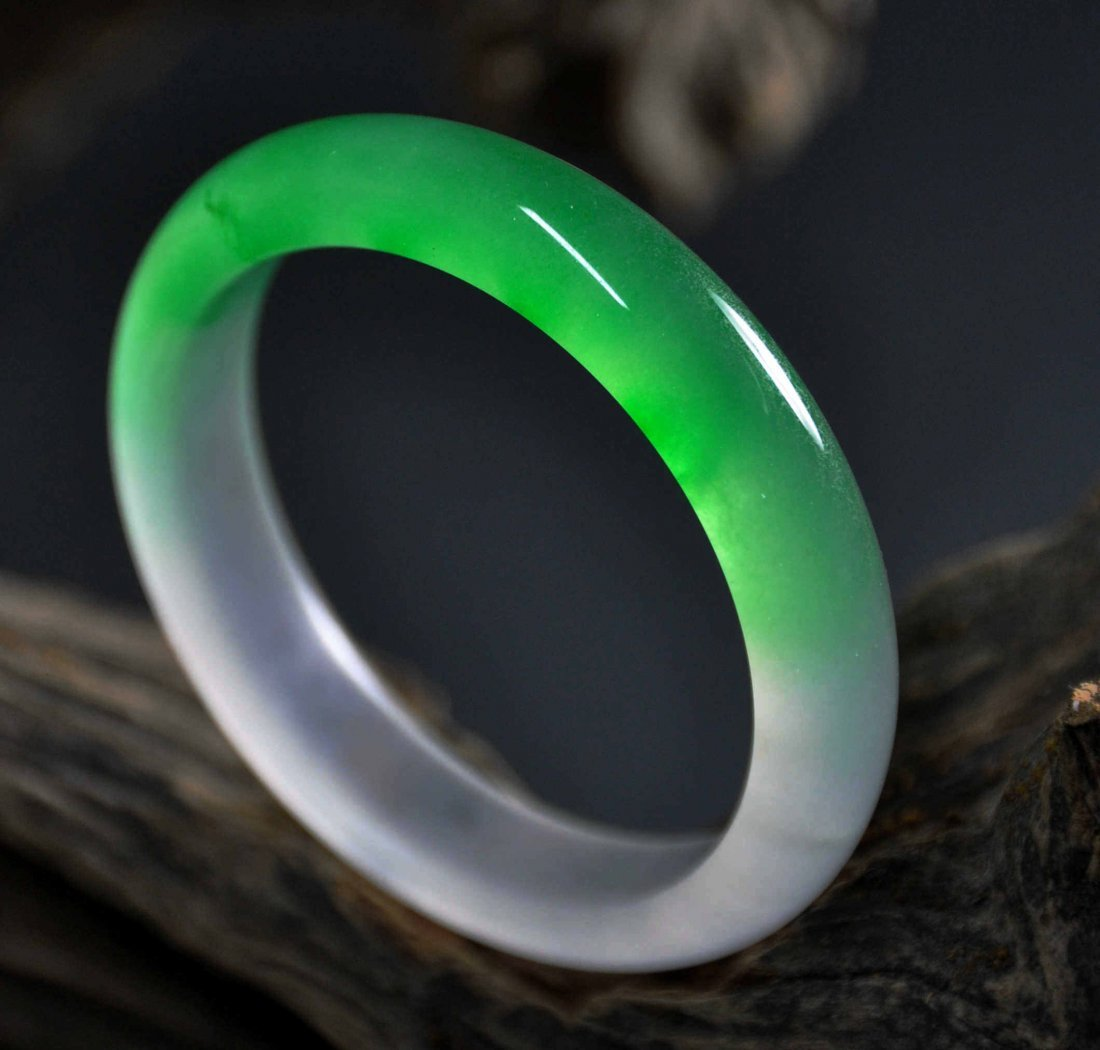 A translucent white and green jadeite bangle
